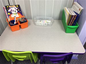 Preschool table used for music games, theory, and iPad work.