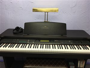 Use the Yamaha Clavinova for warming up while you wait for your lesson to begin.